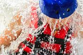 Close-up Strong Man In Red Life Jacket And Blue Helmet In Drops Of Water. Concept: Extreme Sports, R poster