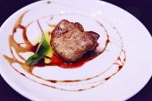 Delicious Fresh Sliced, Pan Seared Foie Gras With Berry Sauce Decoration Served On White Porcelain P poster