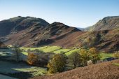 Epic Autumn Fall Landscape Image Of Sleet Fell And Howstead Brow In Lake District With Beautiful Ear poster