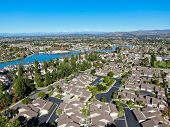 Aerial View Of North Lake Surrounded By Residential Neighborhood During Blue Sky Day In Irvine, Oran poster