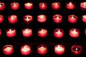 Group Of Red Candles In Church For Faith Resurrection Prayer. Candlelight Fire Flames In Rows Are Si poster
