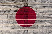 National Flag  Of Japan On A Wooden Wall Background. The Concept Of National Pride And A Symbol Of T poster