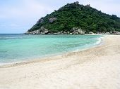 Idyllic Tropical Paradise Beach White Sand And Crystal Clear Sea  Blue Sky With Green Hill Island. poster