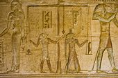 foto of horus  - Ancient Egyptian bas relief carving showing the gods Horus and Anubis weighing a man