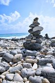 This Is A Calming Rock Tower. Behind This Zen Structure Is The Calming Ocean. Beautiful Seascape. poster
