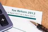 image of self assessment  - Closeup of UK Income tax return form with tax period for 2012 - JPG