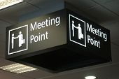 stock photo of reunited  - signage for meeting people at international arrivals at airport - JPG