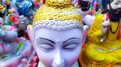 Lord Gotam Buddha Statue With Colsed Eyes In Back Other Statue poster