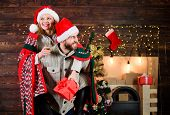 Man And Woman Santa Claus Hats Cheerful Celebrating New Year. Celebrating Winter Holiday. Christmas  poster