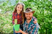 Family Dad And Daughter Planting Plants. Plant Your Favorite Veggies. Planting Season. Family Garden poster