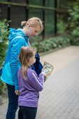 Mother And Her Girl Child Tourists Checking Directions  With Map While Sightseeing City In Europe poster