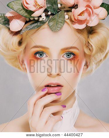 Elegance. Genuine Natural Blonde Bride With Pink Flowers. Artistry