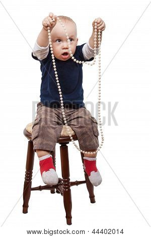 Boy Playing Pearl Necklace