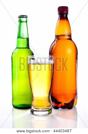 Isolated Glass Beer In Plastic Bottle And Glass Green Bottles With Beer On A White Background