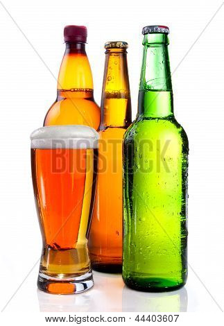 Isolated Glass Beer In Plastic Bottle And Two Glass Bottles With Beer, Brown And Green On A White Ba