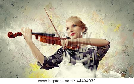 Image of beautiful female violinist playing against splashes background
