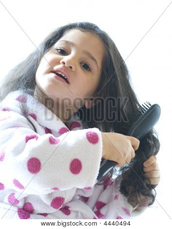 Little Gril Brushing Her Hair