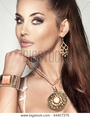 Portrait Of Attractive Brunette Beauty With Beautiful Jewellery.