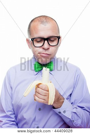 Weird man eating a banana, isolated on white