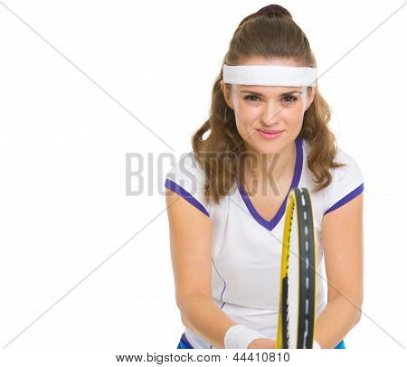 Smiling Female Tennis Player In Stance