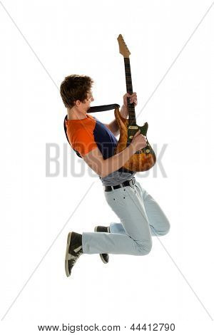 Young guitar player jumping isolated on a white background