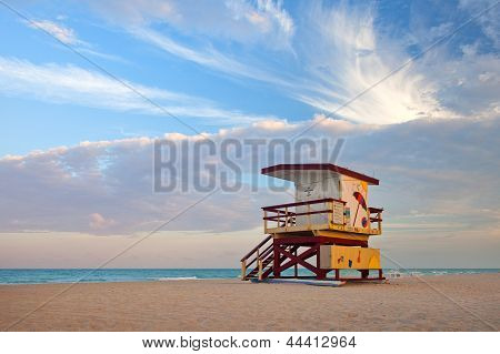 Summer scene in Miami Beach Florida with a colorful lifeguard house