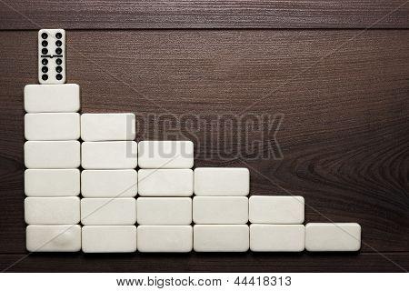 leadership concept domino pieces forming stair