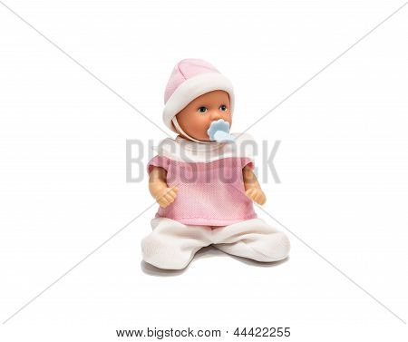 Baby Doll In Pink Clothes Isolated On White Background