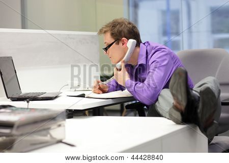businessman on phone looking at screen - bad sitting posture