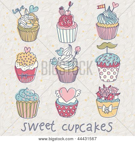 Sweet cupcakes � vector set. Cartoon tasty cupcakes in pastel colors