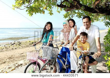 Happy Family With Bikes
