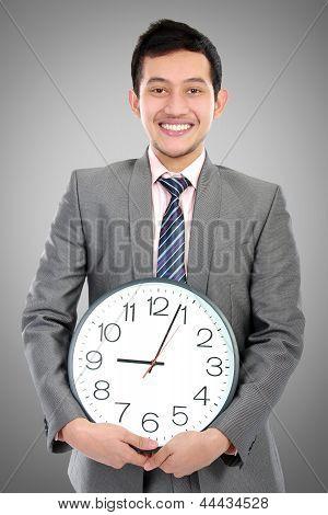 Man Hold Clock