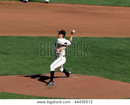 Giants Pitcher Matt Cain Steps Forward With Arm Raised To Throw Pitch
