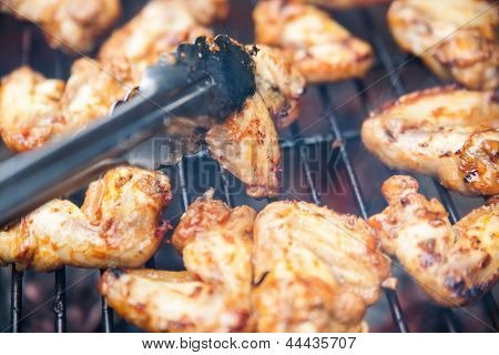 Buffalo wings cooked on grill