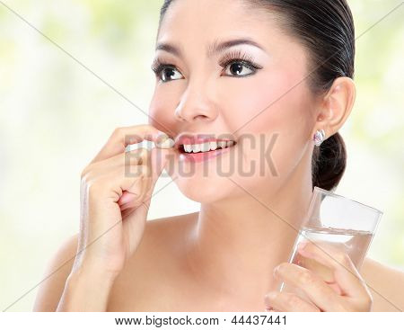 Woman Taking Vitamin Tablet