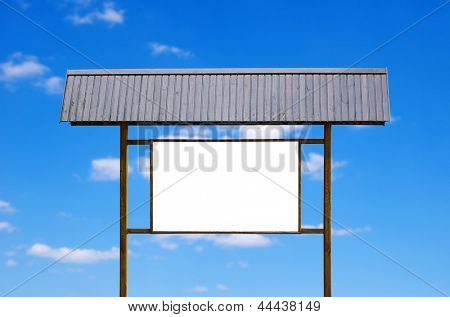 wooden signboard and blue sky