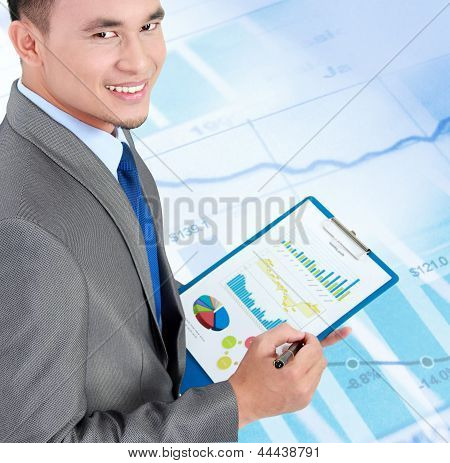 Business Man With Company Annual Report