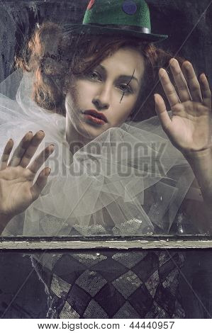 Sad Pierrot Woman Behind The Glass