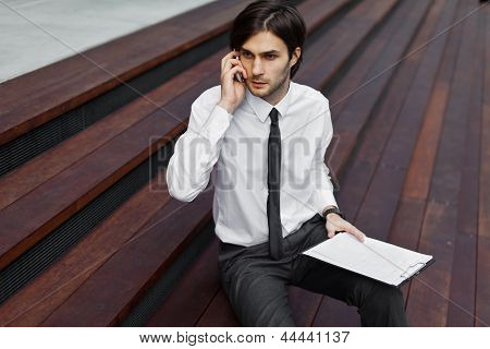 Handsome Young Business Man On A Phone Call