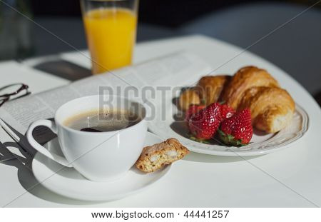 Breakfast. Coffee Cup And Croissant At Sunny Morning