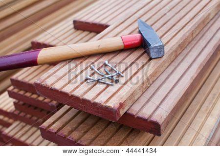 Hammer And Screws On Floorboards
