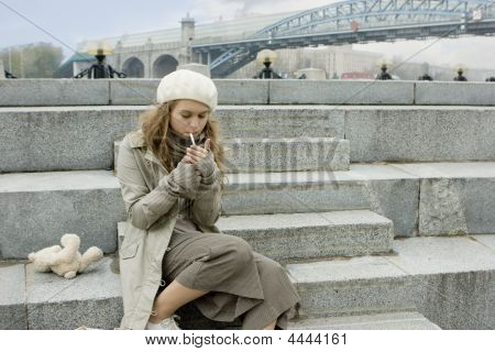 Young Girl Sitting On The Jaggies And Smoking