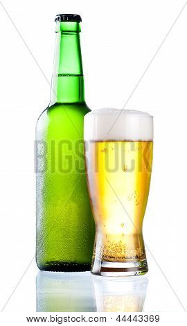 Chilled Green Bottle With Condensate And A Glass Of Beer Lager On Isolated White Background
