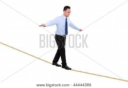 Business Man On Rope  Balancing