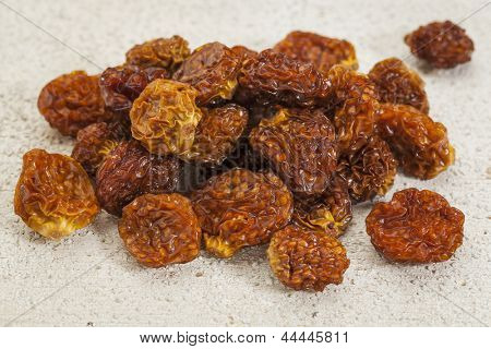 dried goldenberries (physalis peruviana) , superfruit from Peru rich in antioxidnats, vitamin A, bioflavonoids, and dietary fiber, white barn wood background