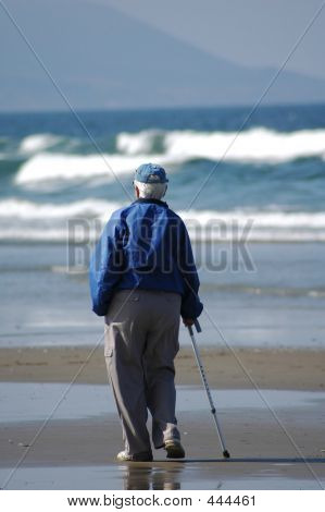 An Old Person On The Beach
