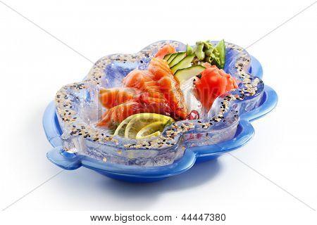 Salmon Sashimi - Sliced Raw Salmon on Daikon (White Radish) with Seaweed, Lime and Cucumber. Garnished on Ice Plate