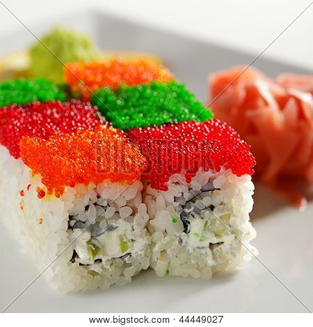 Tobiko Rainbow Maki Sushi - Roll with various type of Tobiko (flying fish roe) outside. Cream Cheese, Fresh Raw Salmon and Avocado inside