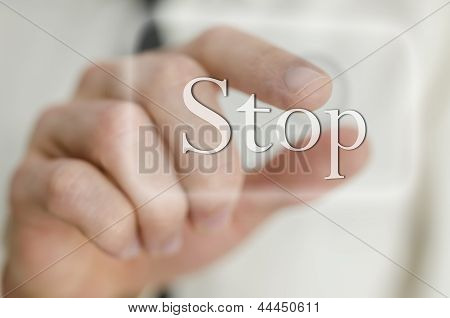 Male Finger Touching Stop Button On A Virtual Screen