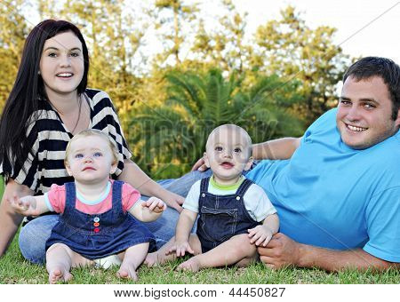 Beautiful young family with twin babies